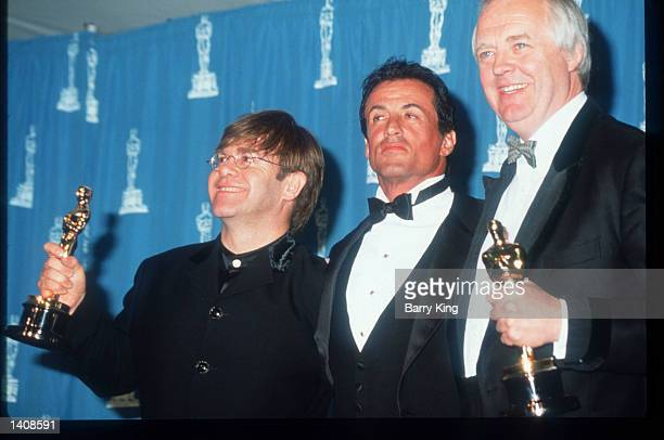 Elton John Sylvester Stallone and Tim Rice attend the 67th Annual Academy Awards ceremony March 27 1995 in Los Angeles CA This year''s ceremony...