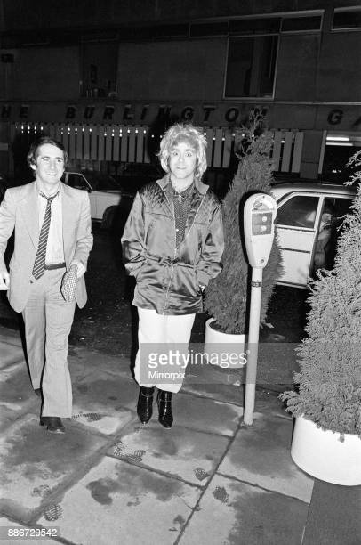 Elton John wearing a woman's wig pictured with his manager John Reid seen arriving at a party to celebrate his London show at Legends Club 3rd April...