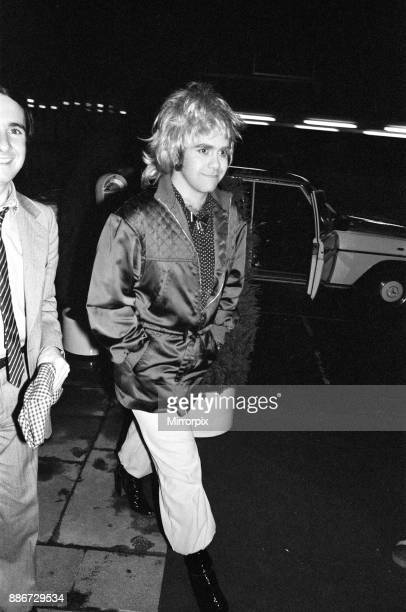 Elton John wearing a woman's wig, seen arriving at a party to celebrate his London show at Legends Club, 3rd April 1979.
