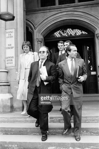 Elton John with Bernie Taupin at the High Court in London They are suing their exmanager Dick James for a bigger share of the £200 million from their...