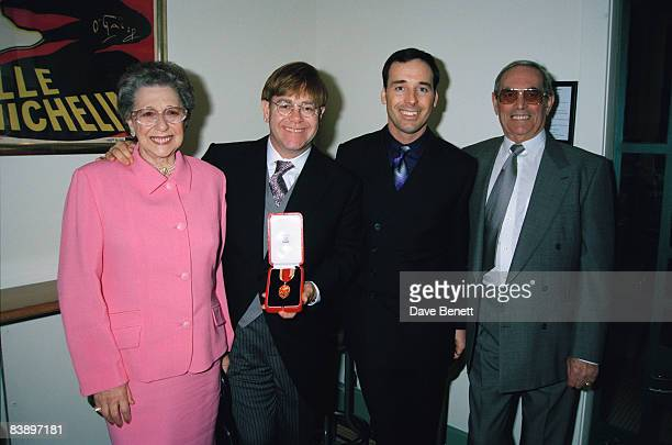 Elton John with his mother Sheila Farebrother his stepfather and his partner David Furnish after receiving his knighthood in London 24th February 1998