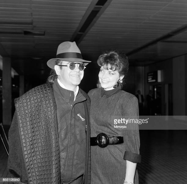 Elton John with his wife Renate arriving from Los Angeles at London Airport 17th October 1986