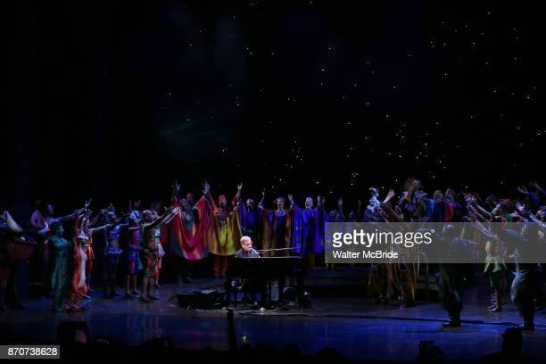 Elton John with the cast performing during the Curtain Call for 20th Anniversary Performance of 'The Lion King' on Broadway at The Minskoff Theatre...