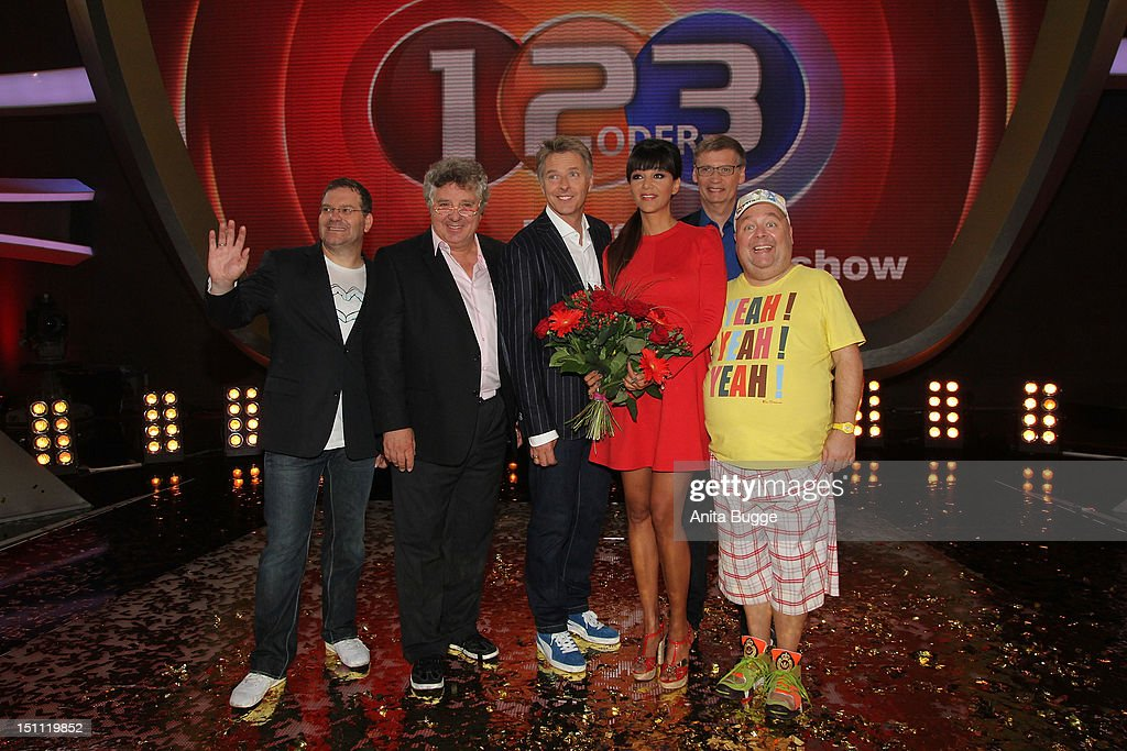 Elton, Michael Schanze, Joerg Pilawa, Verona Pooth, Guenther Jauch and Dirk Bach attend a photocall for '1, 2 oder 3 - Die Grosse Jubilaeumsshow' at Studios Berlin Adlershof on September 1, 2012 in Berlin, Germany.