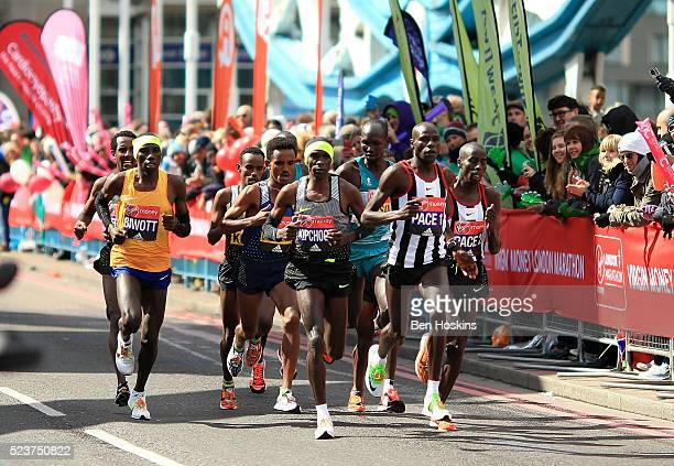 Eluid Kipchoge of Kenya and the elite men make their way under Tower Bridge during the Virgin Money London Marathon on April 24 2016 in London England