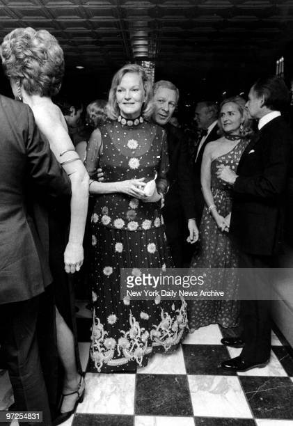 Elusive and mysterious Doris Duke enjoys herself on the dance florr walking behind her is host of party Ray Kassar