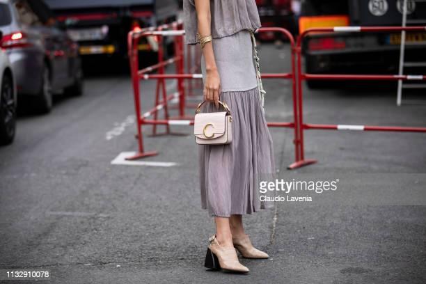 Elva Ni wearing a midi grey dress Chloe white bag and beige mules is seen outside Chloe on Day 4 Paris Fashion Week Autumn/Winter 2019/20 on February...