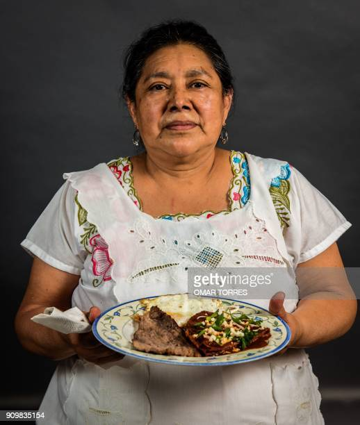 Elvia Valle Jimenez shows her dish of dried beef and drycured smoked beef prepared at her Chofi restaurant in the 20 de Noviembre market in Oaxaca...