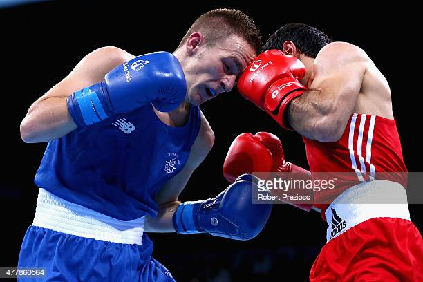 Elvin Mamishzada of Azerbaijan competes against Myles Casey of Ireland in the Boxing Men's Fly Round of 16 during day eight of the Baku 2015 European...