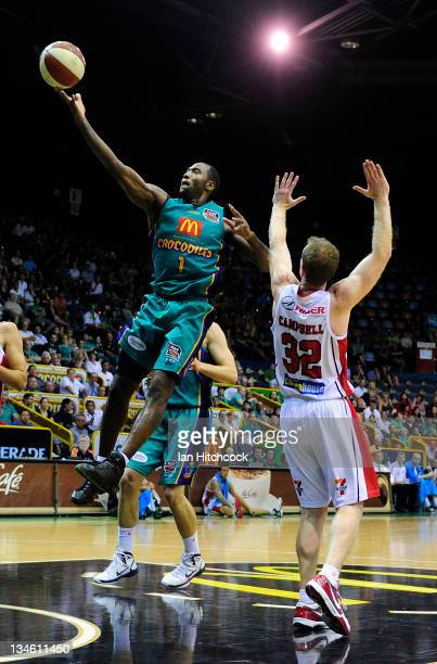 Elvin Mims of the Crococdiles makes a layup past Mat Campbell of the Hawks during the round nine NBL match between the Townsville Crocodiles and the...