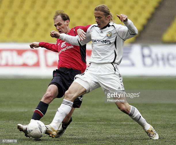 Elvir Rakhimic of CSKA, Moscow competes against Branislav Krunic of Tom, Tomsk during the Russian League Championship match on April 08, 2006 in...