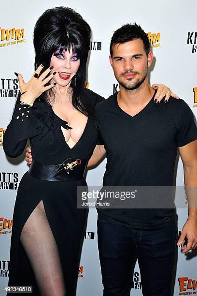 Elvira and Taylor Lautner attend Knott's Scary Farm at Knott's Berry Farm on October 11 2015 in Buena Park California