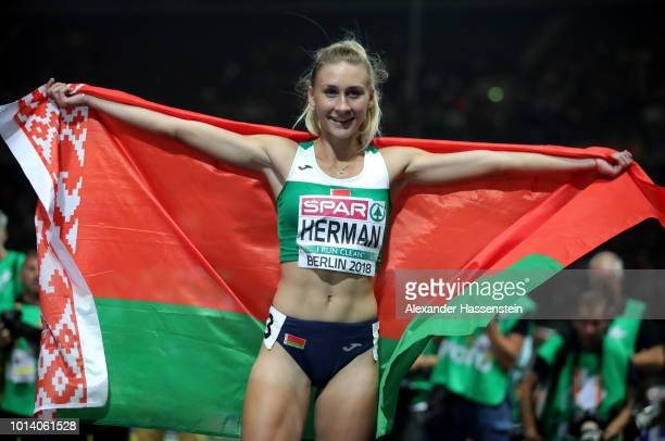Elvira Herman of Belarus celebrates winning Gold in the Women's 100m Hurdles during day three of the 24th European Athletics Championships at...