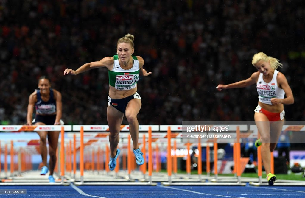 Elvira Herman of Belarus crosses the finish line in the Women's 100m Hurdles Final during day three of the 24th European Athletics Championships at Olympiastadion on August 9, 2018 in Berlin, Germany. This event forms part of the first multi-sport European Championships.