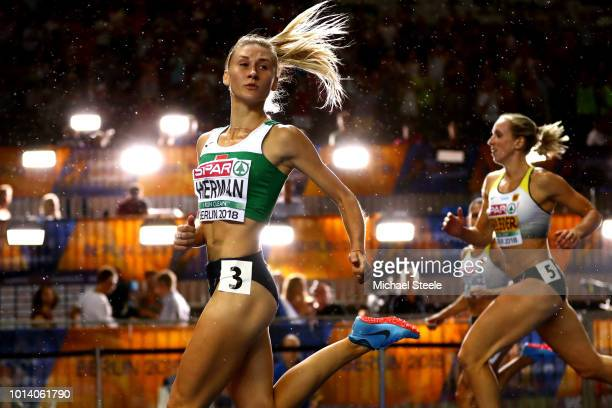 Elvira Herman of Belarus looks on after winning Gold in the Women's 100m Hurdles during day three of the 24th European Athletics Championships at...
