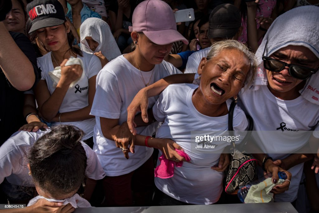 Elvira Miranda, 69, weeps unconsolably during the burial of her son, Leover Miranda on August 20, 2017 in Manila, Philippines. Leover was shot and killed by masked gunmen near their shanty inside the cemetery in Manila. Leover's familyh claims that he has a mental condition. A recent spike in the killings related to the government's anti-drug operation sparked outrage among citizens as police confirmed deaths as high as 35 bodies in one day starting last week. The killing of a 17 year old boy who was collared by police in Caloocan city added to the furor as witnesses claim that they saw police handed the boy a gun and asked him to run before shooting him to death. President Duterte lauded the killing of the 35 people last week and had asked for the killing of more people involved in drugs.