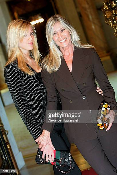 Elvira Netzer wife of Guenther Netzer and their daughter Alana Netzer pose during the reception of the Senate of Hamburg at City Hall October 11 2005...