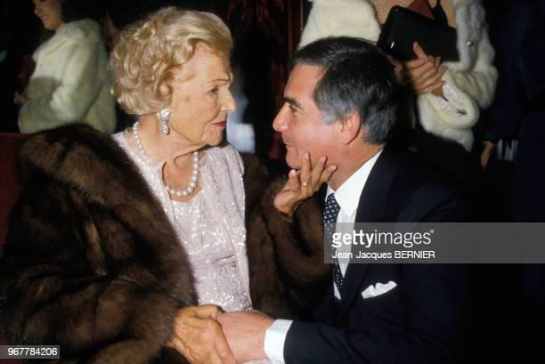 Elvire Popesco et JeanClaude Brialy lors d'un soirée en hommage à Pierre Cardin à Paris le 19 décembre 1983 France