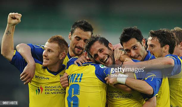 Elvis Abbruscato of Chievo celebrates after scoring his team's second goal with team mates during the Serie A match between AC Chievo Verona and AS...