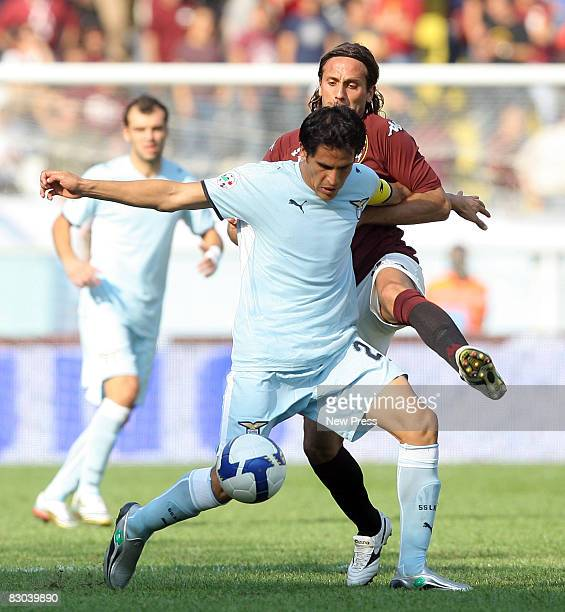 Elvis Abbruscato of Torino and Cristian Daniel Ledesma of Lazio in action during the Serie A match between Torino and Lazio at the Stadio Comunale on...