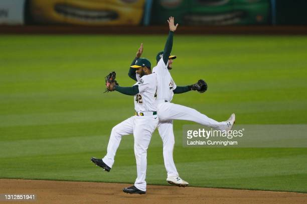 Elvis Andrus and Jed Lowrie of the Oakland Athletics celebrate after a win against the Detroit Tigers at RingCentral Coliseum on April 15, 2021 in...