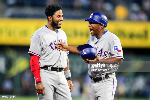 Elvis Andrus and Tony Beasley of the Texas Rangers share a laugh after the fifth inning against the Kansas City Royals at Kauffman Stadium on June 18...