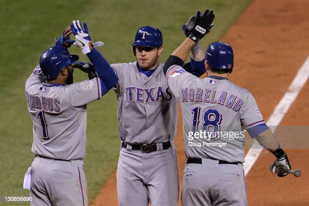 Elvis Andrus Josh Hamilton and Mitch Moreland of the Texas Rangers celebrate after a Hamilton tworun home run in the 10th inning during Game Six of...