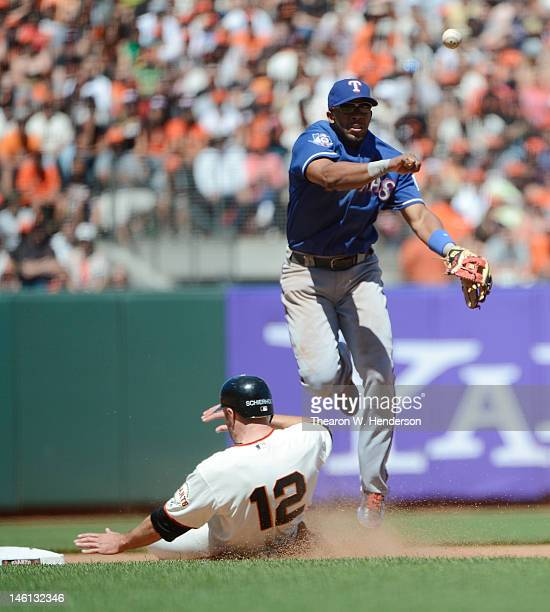 Elvis Andrus of the Texas Ranger gets his throw off to complete the doubleplay while avoiding the slide of Nate Schierholtz of the San Francisco...