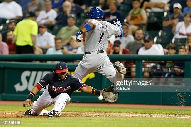Elvis Andrus of the Texas Rangers beats the throw to Carlos Santana of the Cleveland Indians during the sixth inning at Progressive Field on May 26...