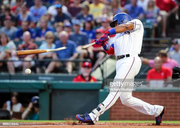 Elvis Andrus of the Texas Rangers breaks his bat on a ground out in the first inning of a baseball game agaisnt the Chicago White Sox at Globe Life...