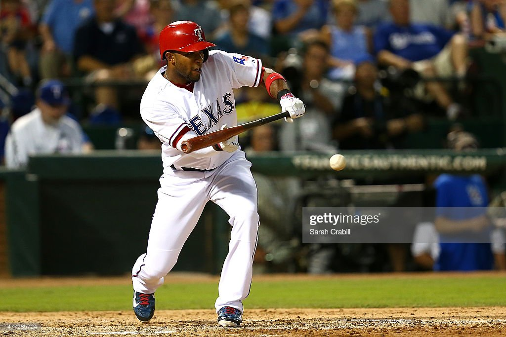 Elvis Andrus #1 of the Texas Rangers bunts during the sixth inning during a game against the Los Angeles Dodgers at Globe Life Park in Arlington on June 15, 2015 in Arlington, Texas. The Texas Rangers defeated the Los Angeles Dodgers 4-1.