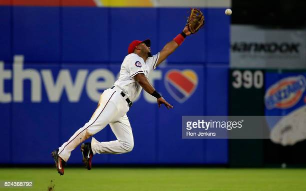 Elvis Andrus of the Texas Rangers can't get to single off the bat of Manny Machado of the Baltimore Orioles during the fourth inning at Globe Life...