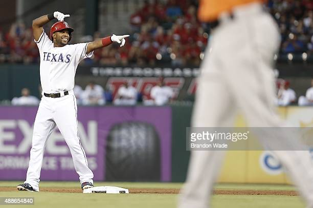 Elvis Andrus of the Texas Rangers celebrates a double during the first inning of a baseball game against the Houston Astros at Globe Life Park on...