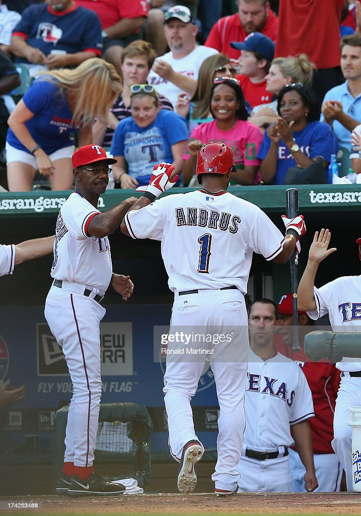 Elvis Andrus #1 of the Texas Rangers celebrates a run against the New York Yankees at Rangers Ballpark in Arlington on July 22, 2013 in Arlington, Texas.