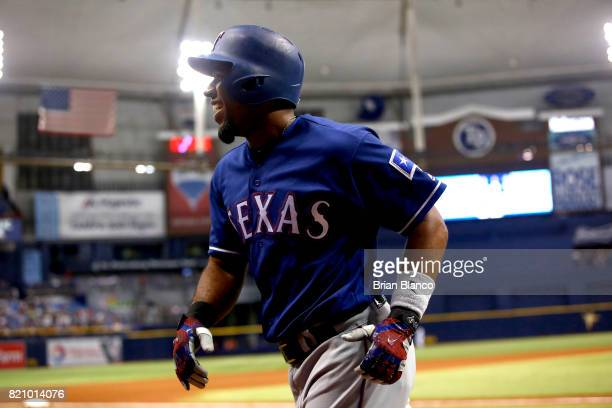 Elvis Andrus of the Texas Rangers celebrates as he runs back to the dugout after hitting a home run off of pitcher Chris Archer of the Tampa Bay Rays...