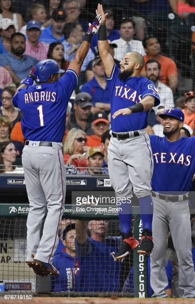 Elvis Andrus of the Texas Rangers celebrates his solo home run with teammate Rougned Odor during the fourth inning against the Houston Astros at...