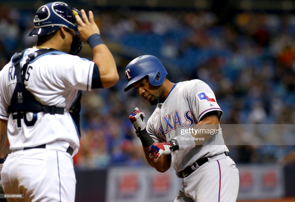 Elvis Andrus #1 of the Texas Rangers celebrates in front of catcher Wilson Ramos #40 of the Tampa Bay Rays after hitting a home run off of pitcher Alex Cobb during the first inning of a game on July 21, 2017 at Tropicana Field in St. Petersburg, Florida.