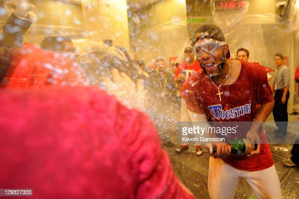 Elvis Andrus of the Texas Rangers celebrates in the clubhouse after defeating the Detroit Tigers in Game Six of the American League Championship...