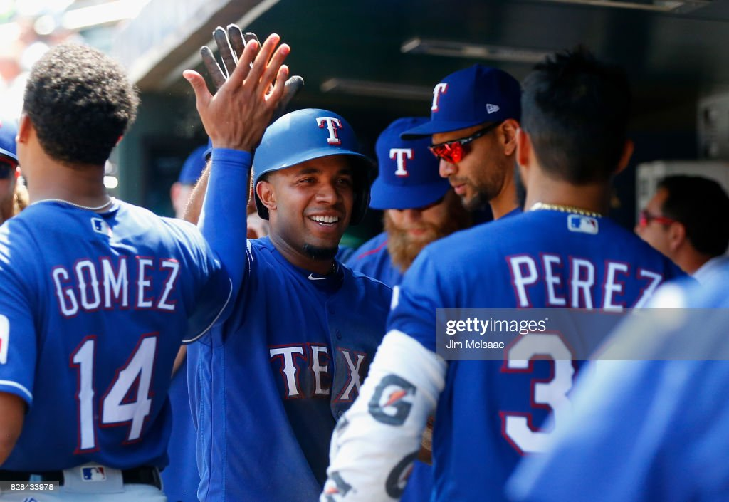 Elvis Andrus #1 of the Texas Rangers celebrates in the dugout with his teammates after scoring a run in the second inning against the New York Mets at Citi Field on August 9, 2017 in the Flushing neighborhood of the Queens borough of New York City.