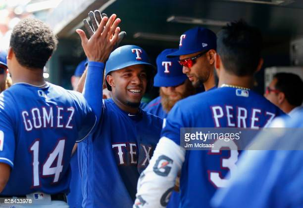 Elvis Andrus of the Texas Rangers celebrates in the dugout with his teammates after scoring a run in the second inning against the New York Mets at...