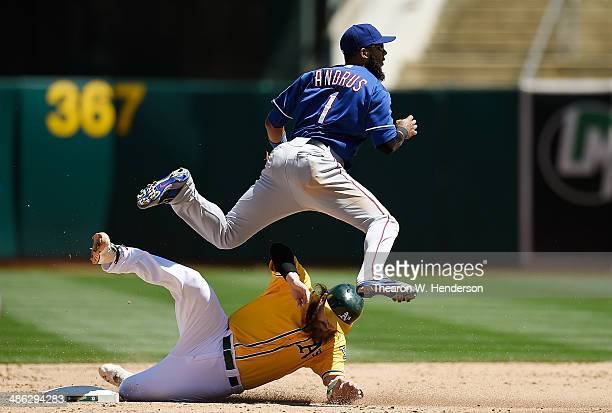 Elvis Andrus of the Texas Rangers completes the doubleplay over the top of Derek Norris of the Oakland Athletics in the bottom of the fifth inning at...