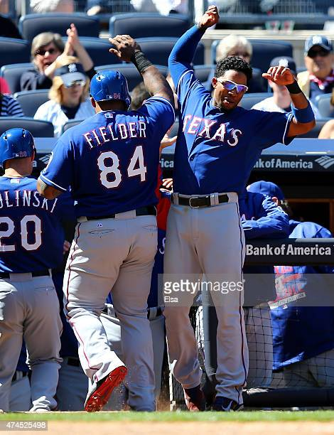 Elvis Andrus of the Texas Rangers congratulates Prince Fielder after Fielder hit a two run homer in the seventh inning against the New York Yankees...