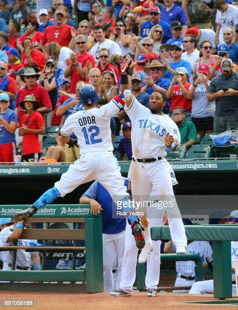 Elvis Andrus of the Texas Rangers congratulates Rougned Odor for hitting a solo home run in the sixth inning against the Seattle Mariners at Globe...