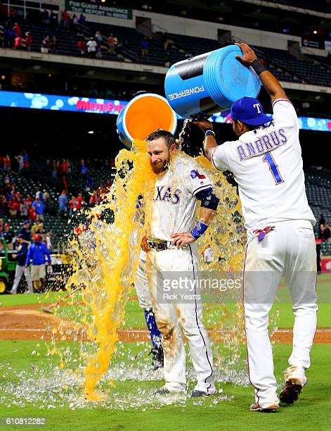 Elvis Andrus of the Texas Rangers dumps the cooler on Jonathan Lucroy at the end of the game against the Milwaukee Brewers at Globe Life Park in...