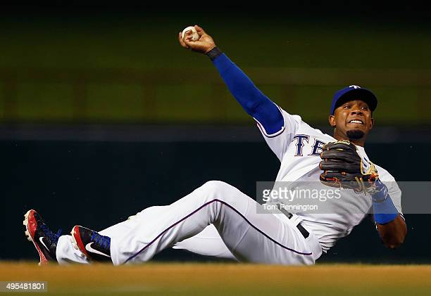 Elvis Andrus of the Texas Rangers fields a an infield single hit by Adam Jones of the Baltimore Orioles in the top of the seventh inning at Globe...
