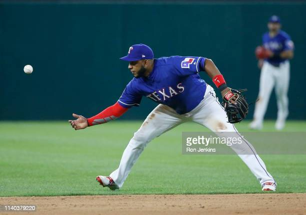 Elvis Andrus of the Texas Rangers fields a ball off the bat of George Springer of the Houston Astros during the fifth inning at Globe Life Park in...