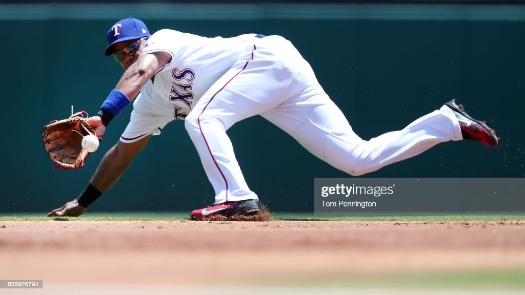 Elvis Andrus #1 of the Texas Rangers fields a ground ball hit by Avisail Garcia #26 of the Chicago White Sox in the top of the first inning at Globe Life Park in Arlington on August 20, 2017 in Arlington, Texas.
