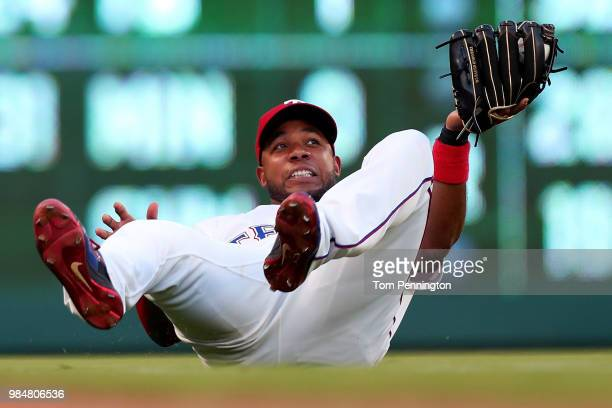 Elvis Andrus of the Texas Rangers fields a popup for the out against the San Diego Padres in the top of the fourth inning at Globe Life Park in...