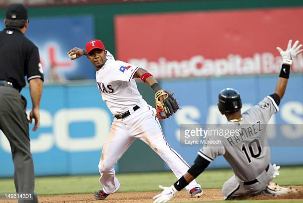 Elvis Andrus of the Texas Rangers forces out Alexei Ramirez of the Chicago White Sox and completes the double play throwing out Dayan Viciedo at...
