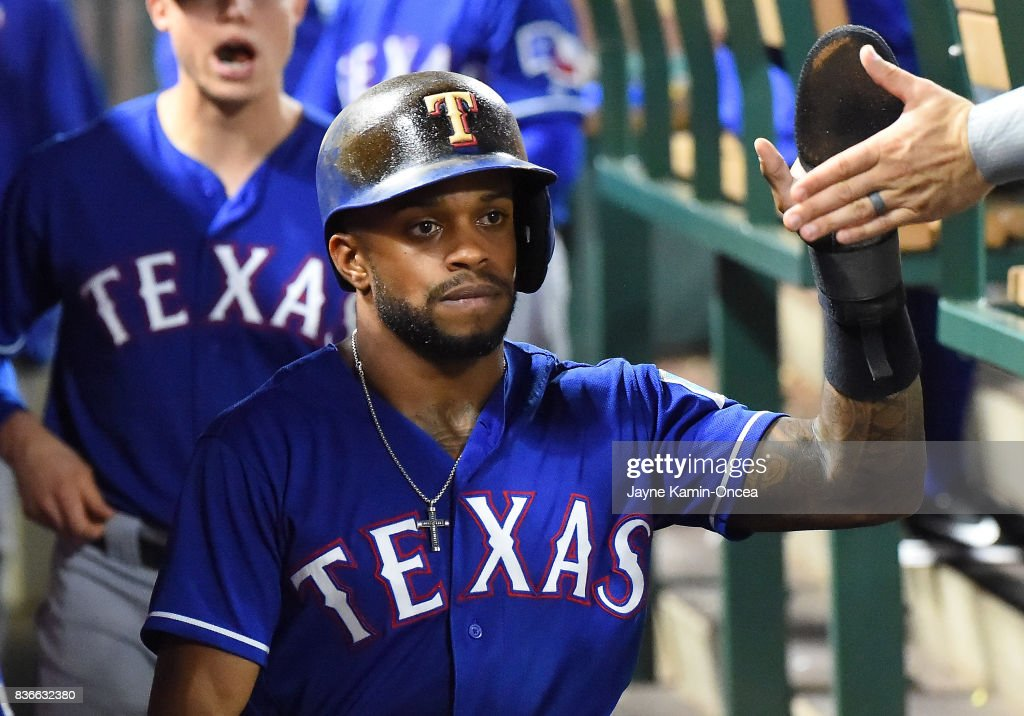 Elvis Andrus #1 of the Texas Rangers gets high fives in the dugout after scoring a run in the third inning of the game against the Los Angeles Angels of Anaheim at Angel Stadium of Anaheim on August 21, 2017 in Anaheim, California.